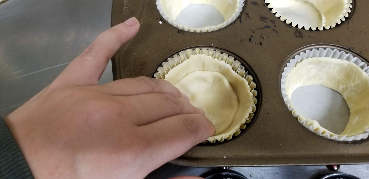 lining cupcake tray with puff pastry