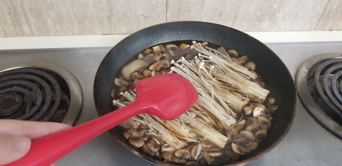 simmering enoki mushrooms, button mushrooms, and shiitake stock for vegan tofu ankake