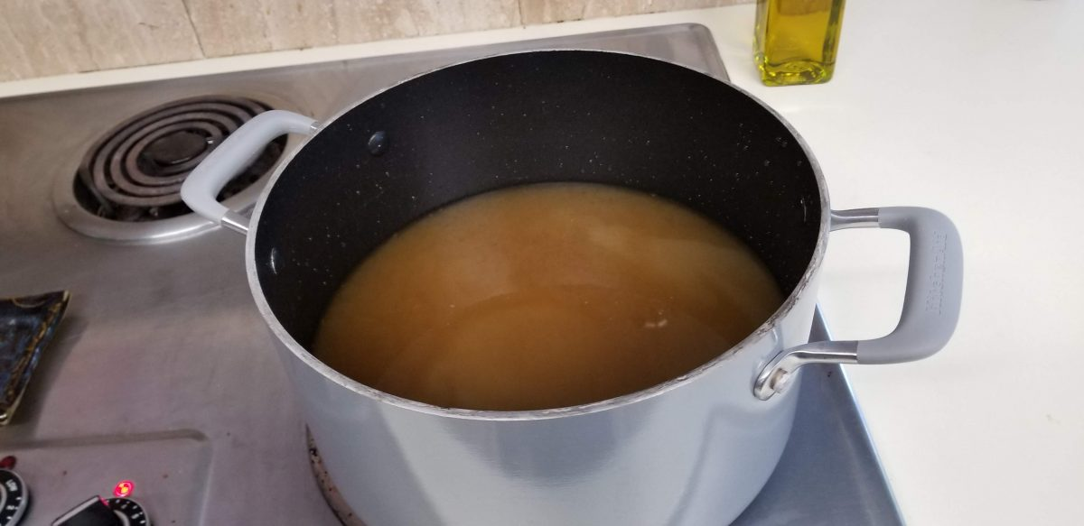 heating vegetable broth in a pot