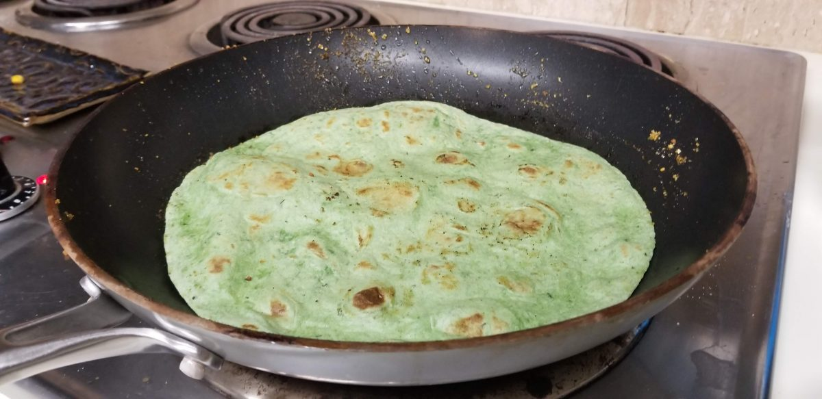 pan frying tortilla for vegan buffalo burritos