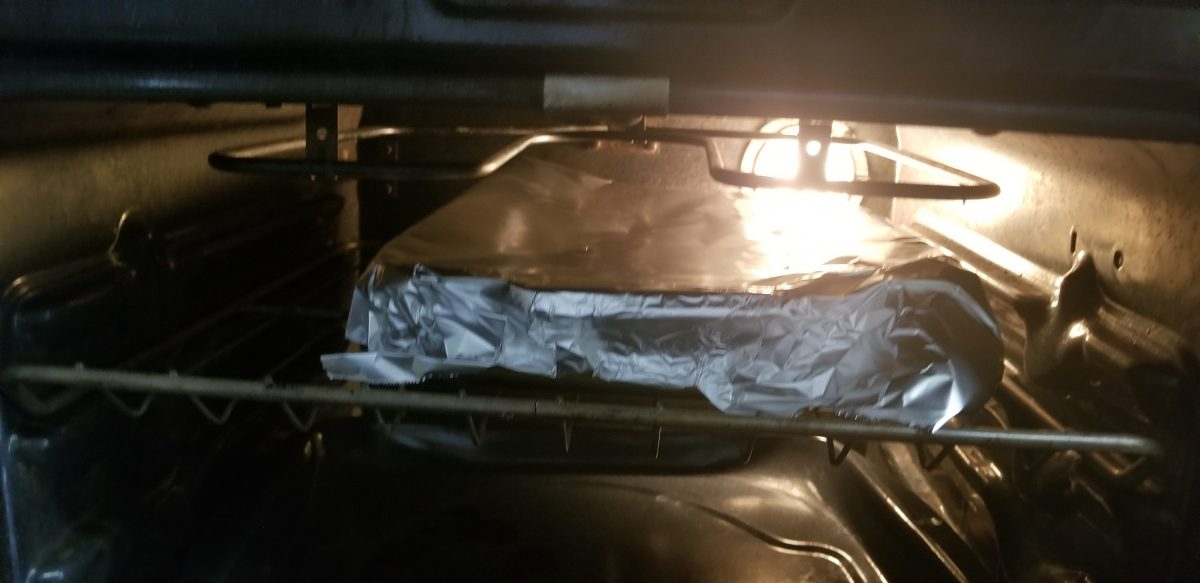 covered casserole in tinfoil cooking