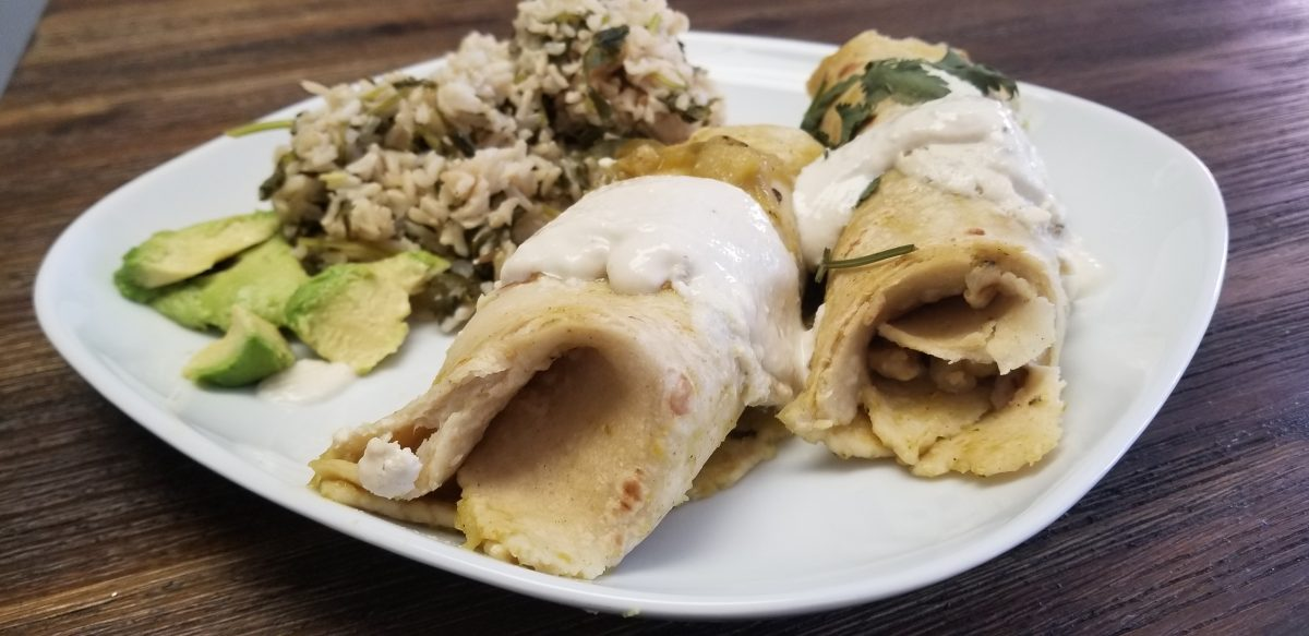 serving vegan enchiladas with tomatillo salsa
