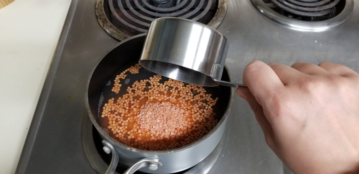 add red lentils to water to cook