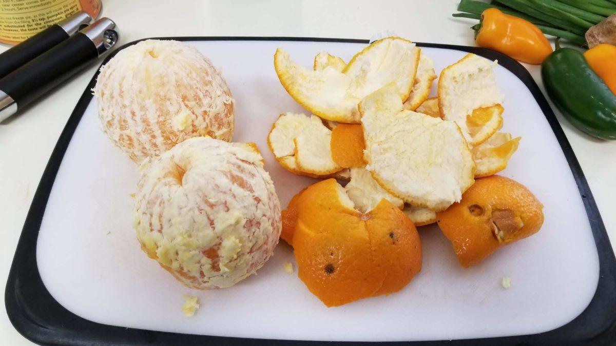 two peeled oranges for vegan orange rice