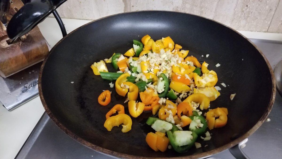 add ingredients to pan for vegan fried rice