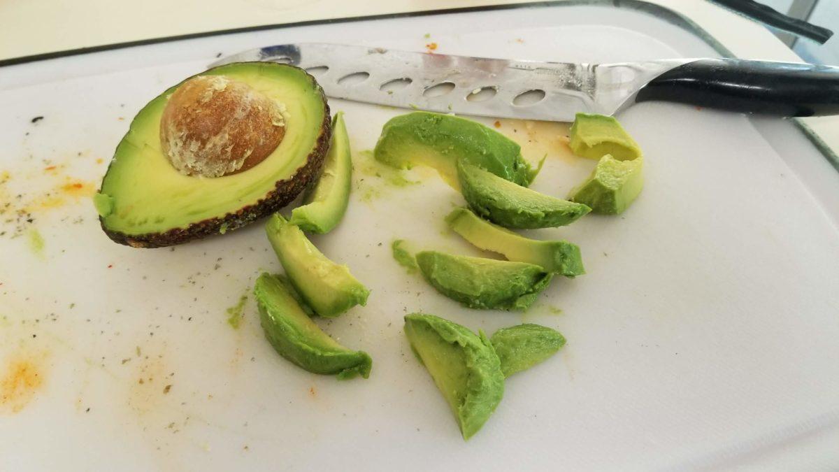 chop avocado for vegan sushi